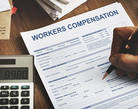 Person completing a Workers Compensation Accident Injury claim form